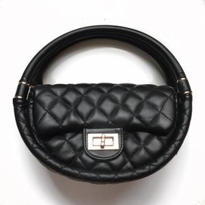 Pre-Loved Circular Quilted Bubble Handbag. Black.